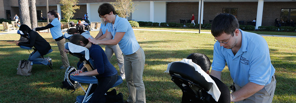 Massage Therapy students, giving massages