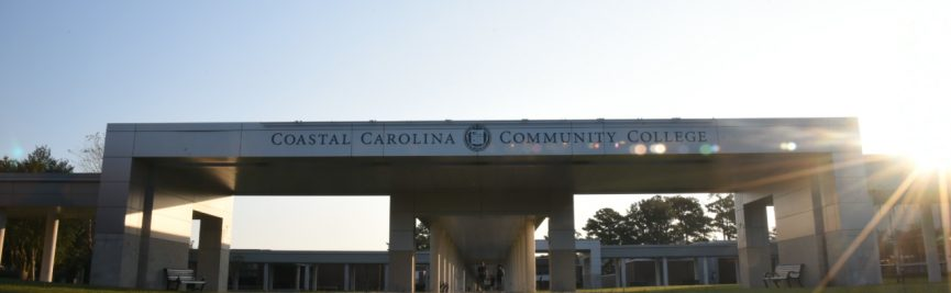 Large Coastal Sign on campus covered walkway