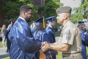 a photo of a graduate being congratulated